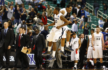 Xavier Musketeers guard Mark Lyons and forward Justin Martin celebrate after their team defeated Lehigh Mountain Hawks during college basketball game in Greensboro
