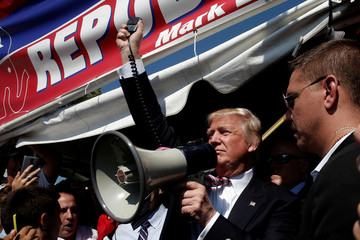 Republican presidential nominee Donald Trump uses a bullhorn to speak to supporters during a campaign stop at the Canfield County Fair in Canfield