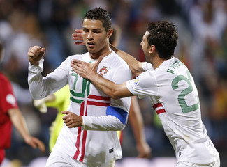 Portugal's Cristiano Ronaldo celebrates his goal with team mate Helder Postiga during their 2014 World Cup Qualifying match against Luxembourg in Luxembourg