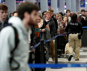 Travelers wait in security check point line at O'Hare Airport before the busy Thanksgiving Day weekend in Chicago