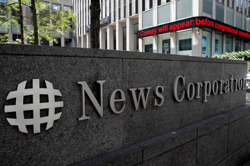 The News Corporation logo is seen outside their headquarters building, home to Fox News, in New York