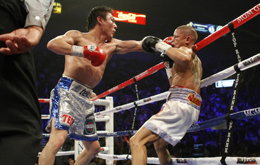 Jorge Arce of Mexico connects on WBO super bantamweight champion Wilfredo Vazquez of Puerto Rico during their title fight at the MGM Grand Garden Arena