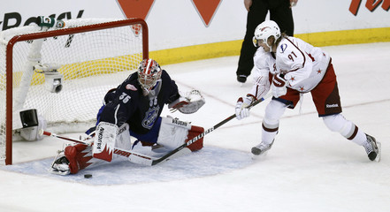 Detroit Red Wings goalie Jimmy Howard of Team Chara stops Tampa Bay Lightning Steven Stamkos of Team Alfredsson on a penalty shot during the NHL All-Star hockey game in Ottawa