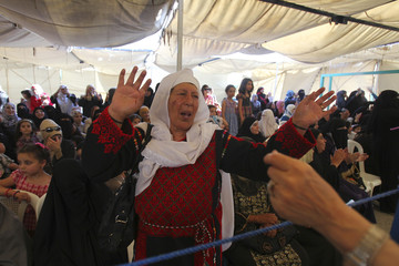 Relatives celebrate during a mass wedding ceremony in Amman
