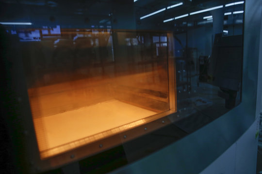 Selective laser sintering SLS 3D printer is seen inside the Shapeways 3D printing office in the borough of Queens in New York
