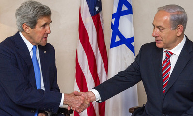 U.S. Secretary of State Kerry shakes hands with Israel's PM Netanyahu during their meeting in Jerusalem