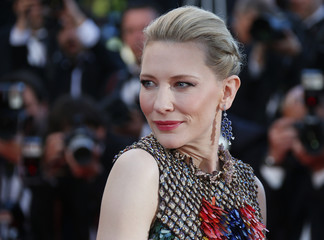 """Actress Cate Blanchett poses on the red carpet as she arrives for the screening of the film """"How to Train Your Dragon 2"""" out of competition at the 67th Cannes Film Festival in Cannes"""