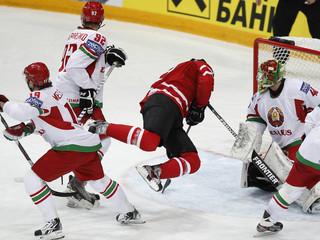 Canada's Kane fights for puck with Belarus' goalkeeper Milchakov, Meleshko and Graborenko during their 2012 IIHF men's ice hockey World Championship game in Helsinki
