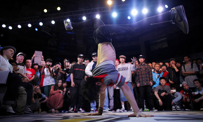 Dancer performs during the 2013 B-BOY Shanghai breakdancing competition in Shanghai
