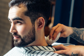 portrait of handsome man with beard in barbershop
