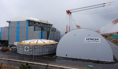 Hitachi logos are seen on Electric Power Development Co. Oma Nuclear Power Station under construction in Oma town