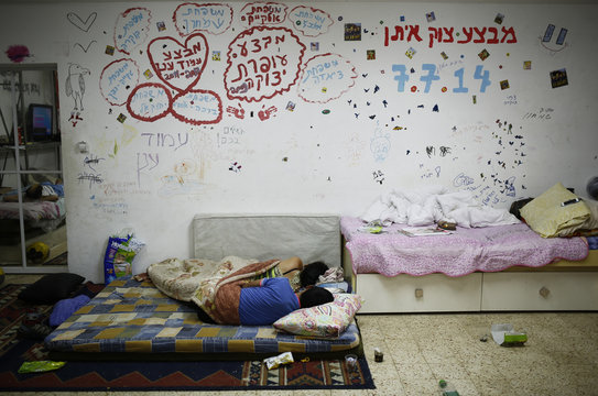An Israeli couple sleeps in a public bomb shelter in the southern city of Ashkelon