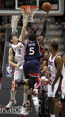 Hawks Smith makes a lay up with Bucks Ilyasova defending in Game 6 of their NBA Eastern Conference playoff in Milwaukee