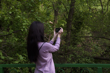 Woman tourist taking picture landscape