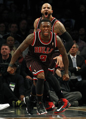Chicago Bulls point guard Robinson and forward Boozer react after Robinson made a go ahead basket against the Brooklyn Nets in their NBA basketball game in New York