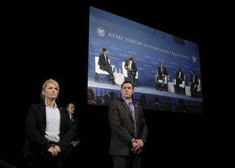 U.S. Secret Service officers stand in front of a large monitor as U.S. Republican presidential candidates participate in a forum at the 2016 Kemp Forum on Expanding Opportunity in Columbia