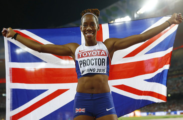 Second placed Proctor of Britain celebrates with a national flag after competing in the women's long jump final during the 15th IAAF World Championships at the National Stadium in Beijing