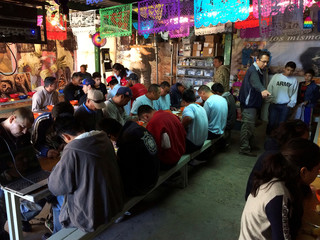 "Migrants have breakfast at ""El Comedor"" migrant center in Nogales, in Sonora state, Mexico"