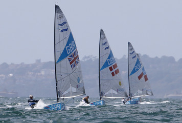 Britain's Ben Ainslie sails ahead of Denmark's Jonas Hogh-Christensen during the tenth race of the Finn sailing class at the London 2012 Olympic Games