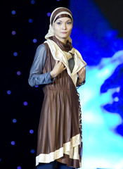 A model presents an outfit at the first National Islamic Fashion contest in Almaty