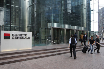 People enter and leave the headquarters of French bank Societe Generale at La Defense, west of Paris