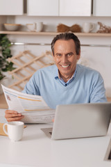 Delightful old man enjoying morning routine at home