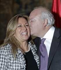 Outgoing Foreign Minister Moratinos kisses new Foreign Minister Jimenez in Madrid