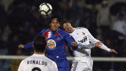 Real Madrid's Gago and Getafe's Parejo head the ball during their Spanish first division soccer match in Getafe