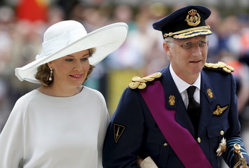 Belgium's King Philippe and Queen Mathilde arrive at a religious service at the Sainte-Gudule cathedral in Brussels