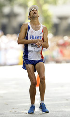 Diniz from France crosses the finish line to win the men's 50 km walk at the European Athletics Championships in Barcelona