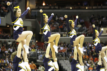 Marquette Golden Eagles cheerleaders perform in the game against the Syracuse Orange during the second half in their East Regional NCAA men's basketball game in Washington