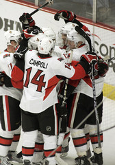 Senators celebrate a goal against the Blackhawks during their game in Chicago