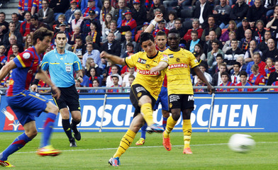 YB's Costanzo scores a goal next to Mayuka and FC Basel's Abraham during their Swiss Super League soccer match in Basel