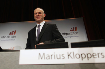 Marius Kloppers, BHP Billiton Chief Executive, arrives to the half-year results news conference in central Sydney