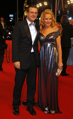 German TV presenter Burkard and her partner Mahr pose on the red carpet as they arrive for the 63rd Bambi media award ceremony in Wiesbaden