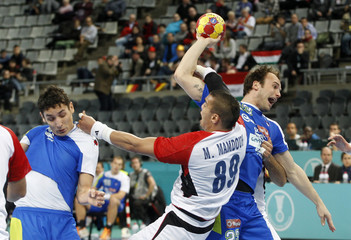 Slovenia's Zorman attempts to score against Egypt's Mamdouh during their World Men's Handball Championship match at Palau Sant Jordi arena in Barcelona