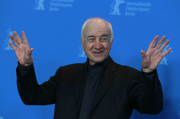 German actor Mueller-Stahl gestures during photocall before ceremony to receive Honorary Golden Bear at 61st Berlin International Film Festival in Berlin