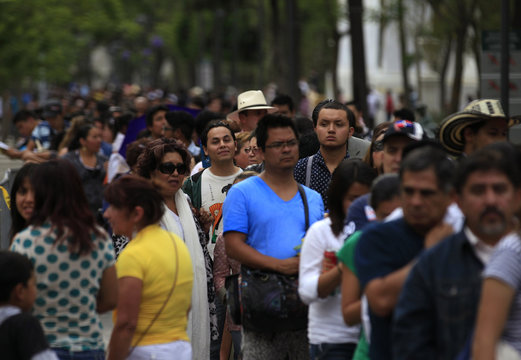 Hundreds of people line up to enter the Palace of Fine Arts for a public viewing of the ashes of late Colombian Nobel laureate Gabriel Garcia Marquez in Mexico City