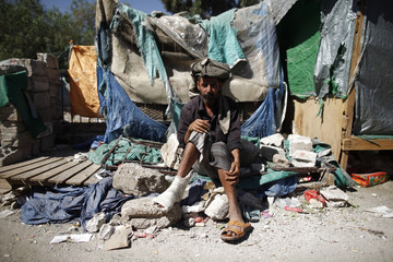 Protester sits outside his makeshift hut at a pro-democracy protest camp in Sanaa