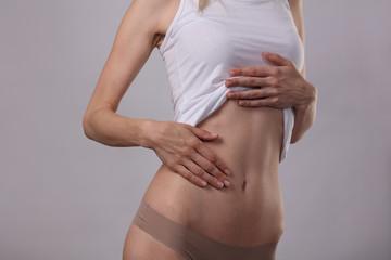 Healthy attractive woman body, waistline. Slim female torso, waist,, abdomen close up. Sport, fitness, Dieting results,laser lipolysis, active lifestyle concept