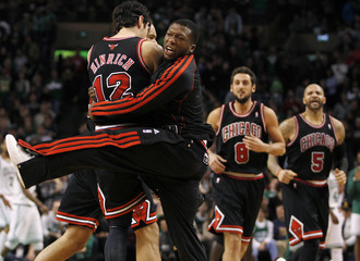 Chicago Bulls' Hinrich is congratulated by Robinson after a basket during their NBA basketball game against Boston Celtics in Boston