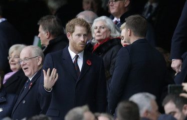 Britain's prince Harry looks on from the stands before the match