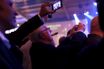 Cigar enthusiasts take pictures during the gala dinner for the closing of the XVIII Habanos Festival in Havana