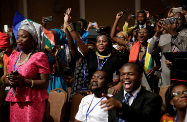 Members of the audience react before U.S. President Barack Obama takes the stage at a Young African Leaders Initiative town hall in Washington