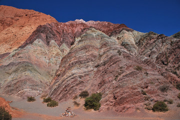 Foto auf Leinwand Hugel The hill of seven colors (cerro de los siete colores) at Purmamarca, UNESCO world heritage quebrada de humahuaca, Jujuy, Argentina