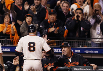 San Francisco Giants' Pence is congratulated by manager Bochy after hitting an RBI sacrifice fly against the Detroit Tigers in the eighth inning during Game 2 of the MLB World Series baseball championship in San Francisco