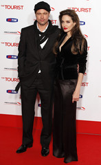"U.S. actors Jolie and Pitt pose for pictures as they arrive for the Italian premiere of the movie ""The Tourist"" in Rome"