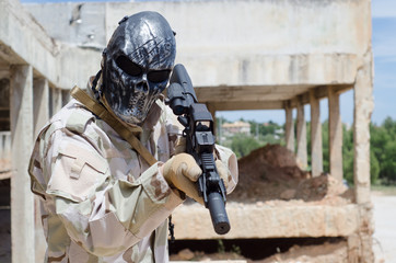 Soldier with scary mask aim target