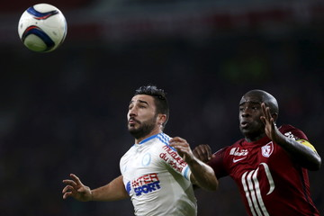 Romain Alessandrini of Olympique Marseille fights for the ball with Lille's Antonio Mavuba during their French Ligue 1 soccer match at the Pierre Mauroy stadium in Villeneuve d'Ascq near Lille