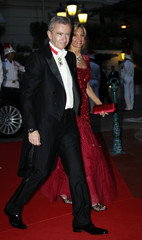 LVMH Chief Executive Arnault and his wife Helene Mercier-Arnault arrive at the Opera Garnier to attend the official dinner and ball for the wedding of Monaco's Prince Albert II and Princess Charlene in Monaco